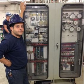 Man standing next to a pressure meter board