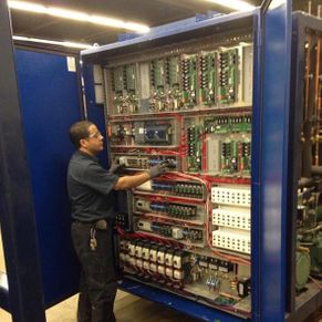 man checking the commercial electrical main circuit board